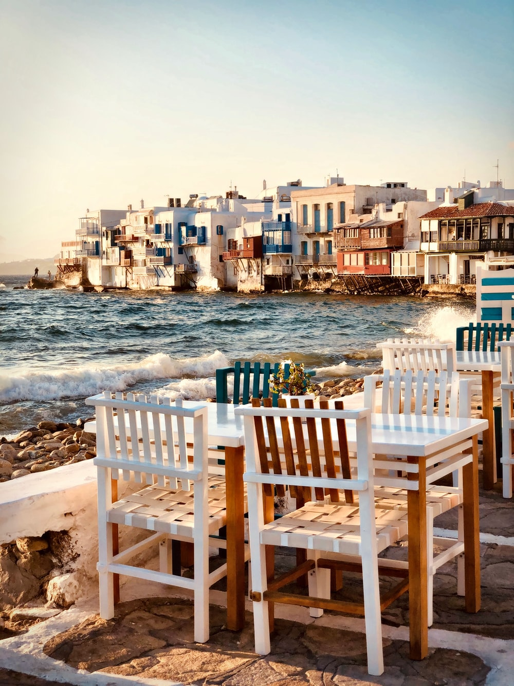 brown wooden chairs on seashore during daytime