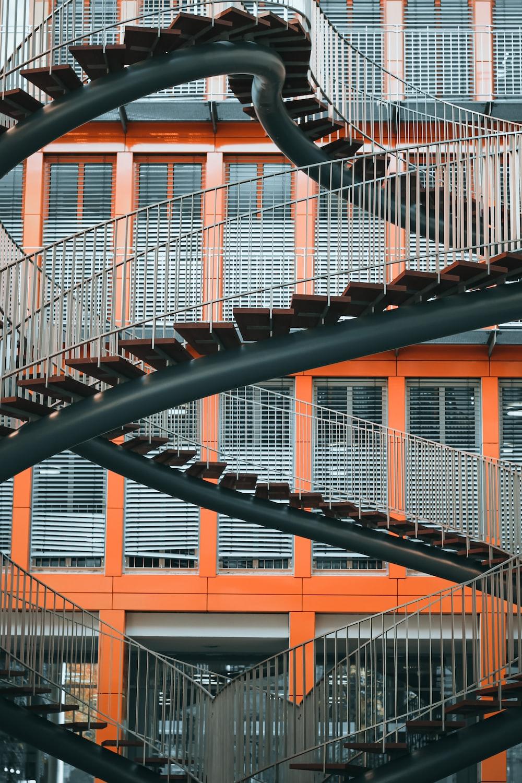 black metal railings near brown concrete building during daytime