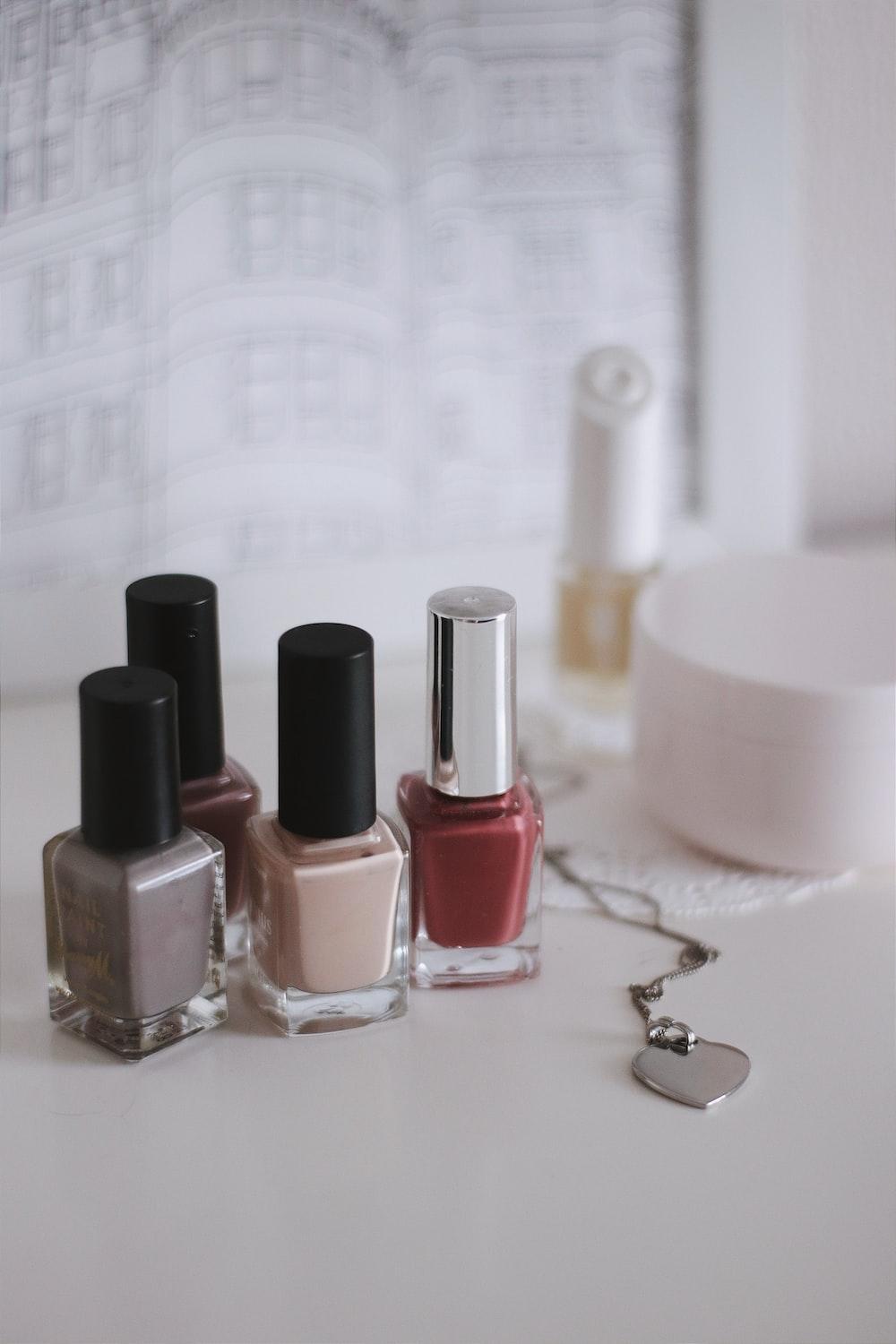 pink and black nail polish bottles
