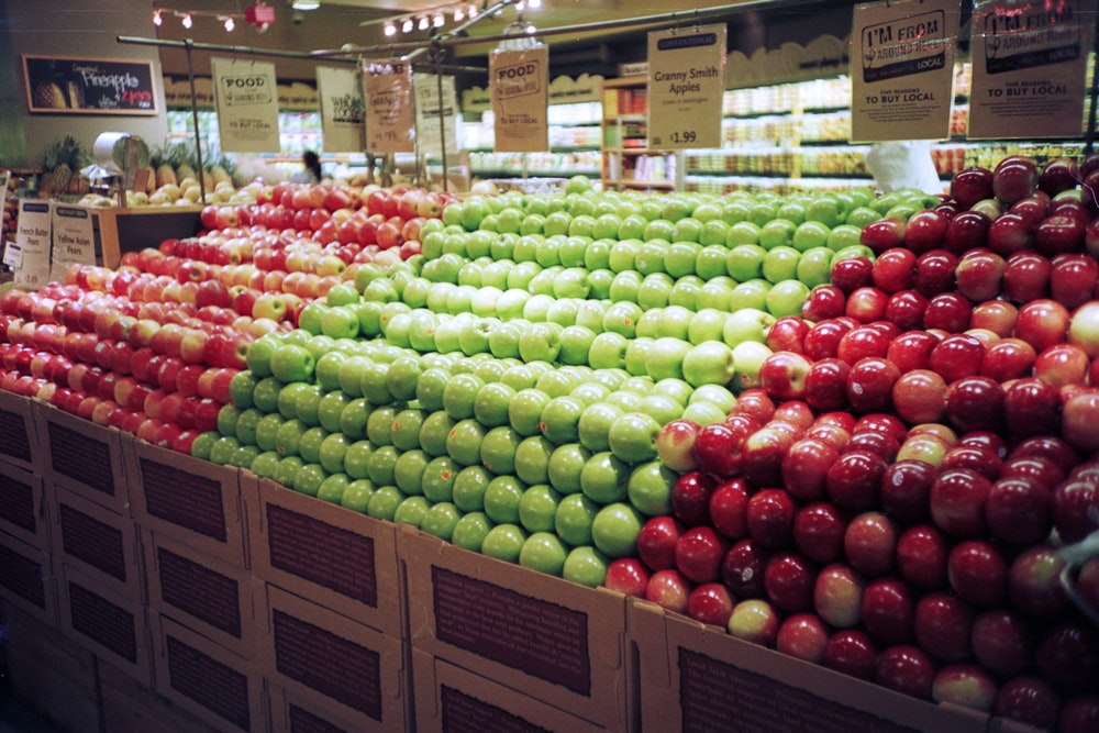 red and green apples on brown wooden crate