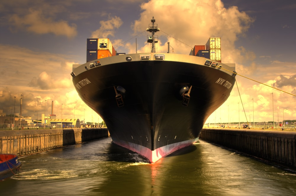 black and red ship on dock during daytime
