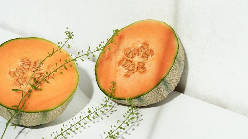 sliced orange and green fruit