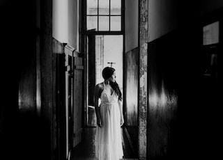 woman in white dress walking on hallway