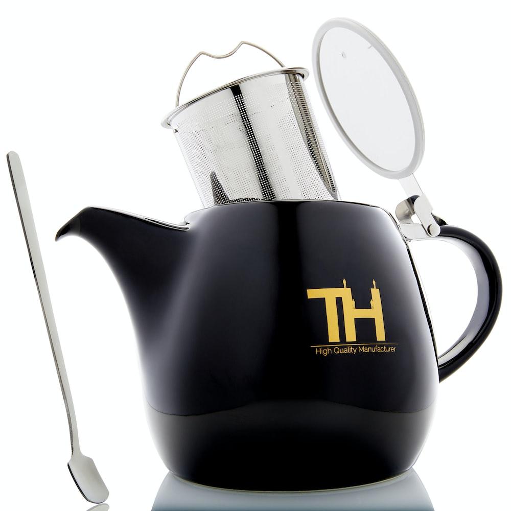 black and yellow ceramic teapot