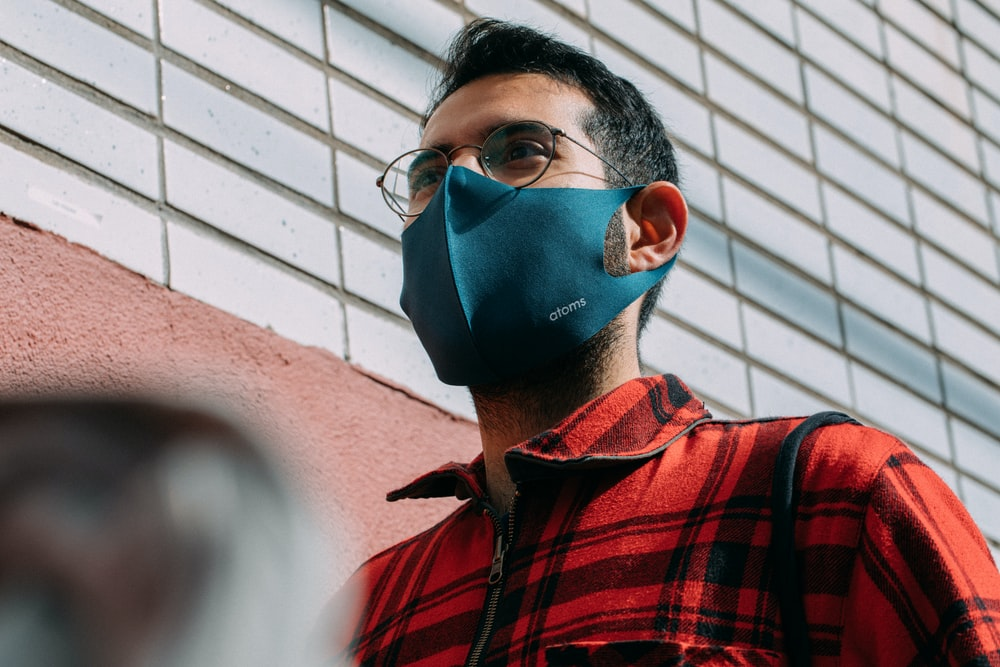 boy in red and black checkered button up shirt wearing blue mask
