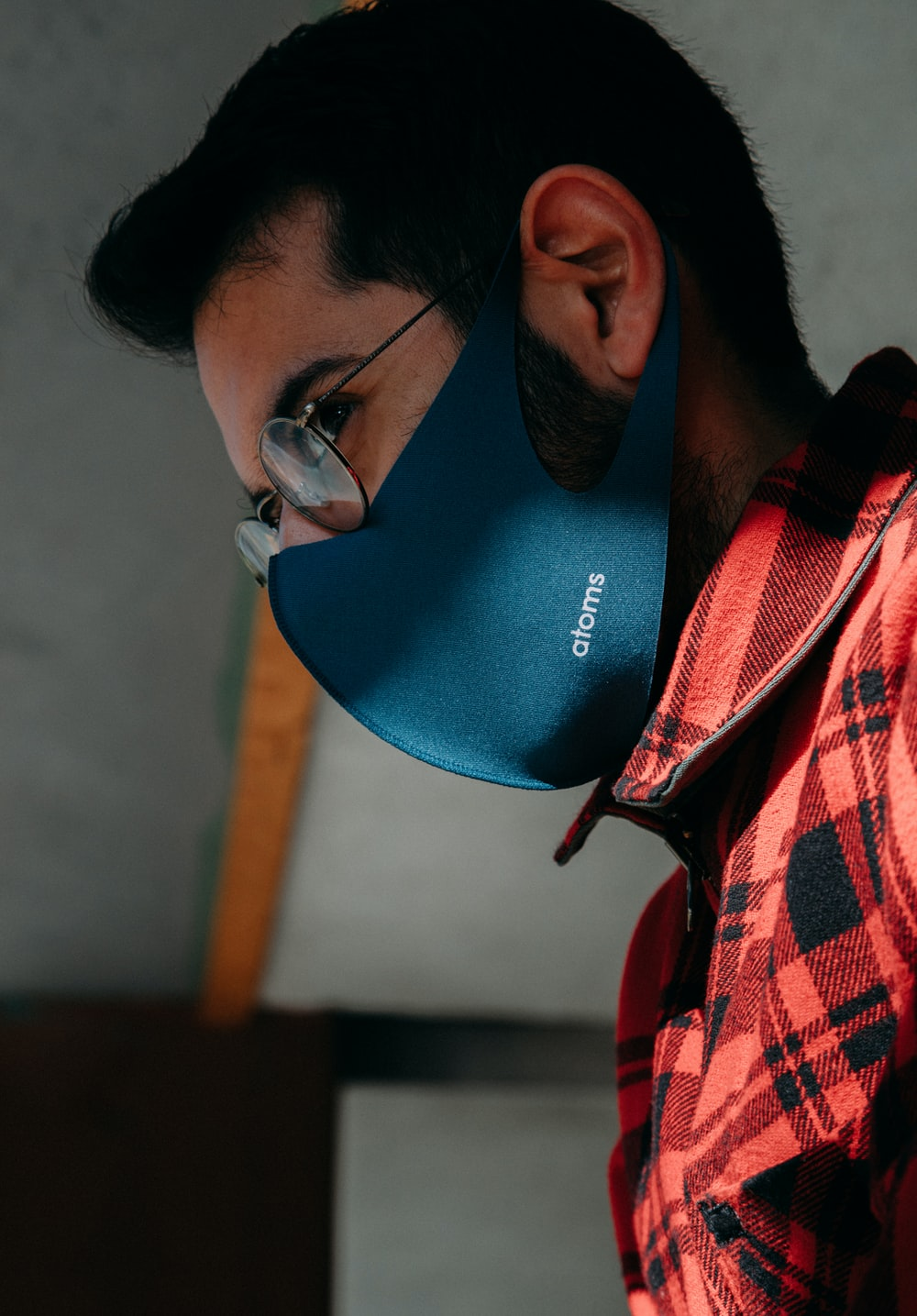 man in red and white plaid shirt wearing blue and white goggles