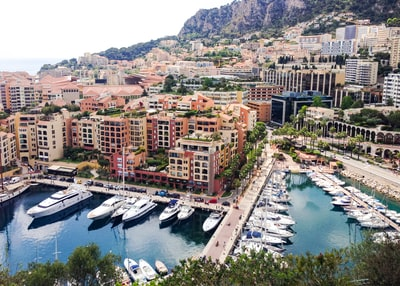 aerial view of city buildings near body of water during daytime monaco teams background