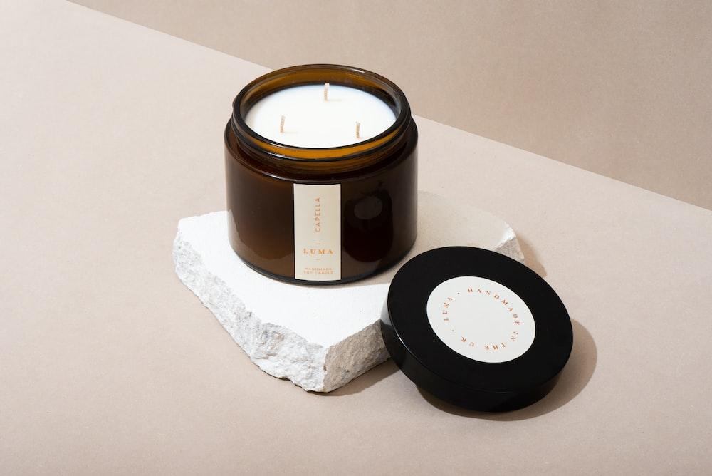 black round container on white tissue paper