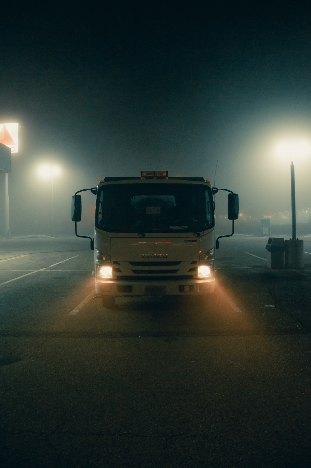 white truck on road during night time