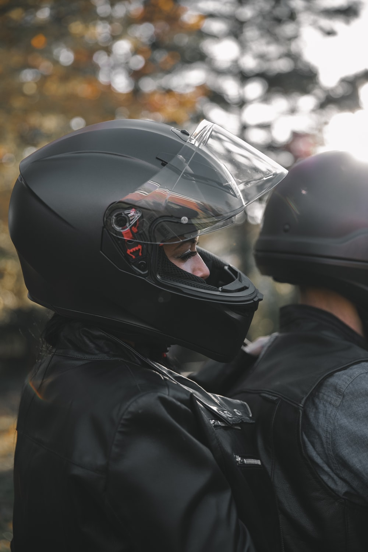 person wearing black helmet and black jacket