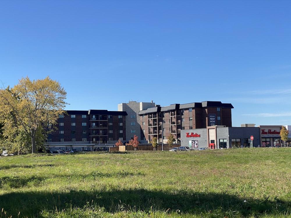 green grass field near building during daytime