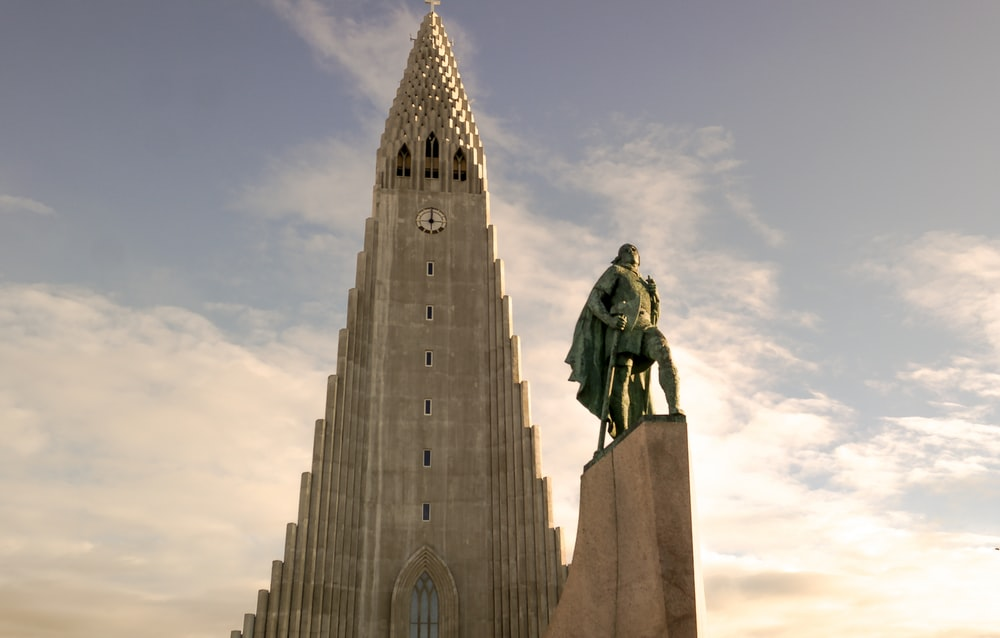 statue of man on top of building