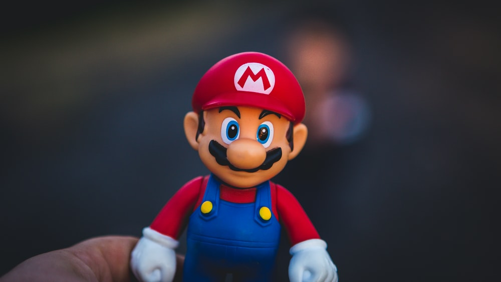 super mario in blue and red shirt figurine