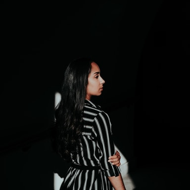 woman in black and white striped long sleeve shirt