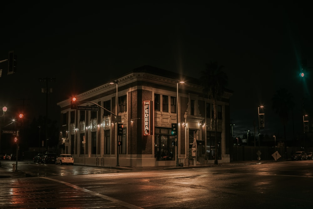 white and brown concrete building during night time