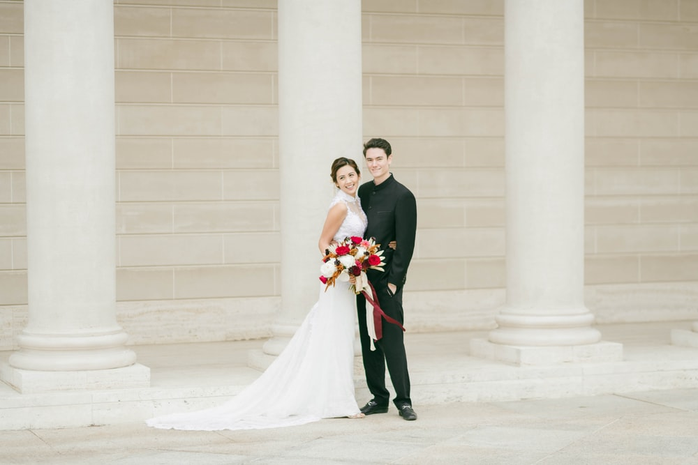 bride and groom standing on white floor