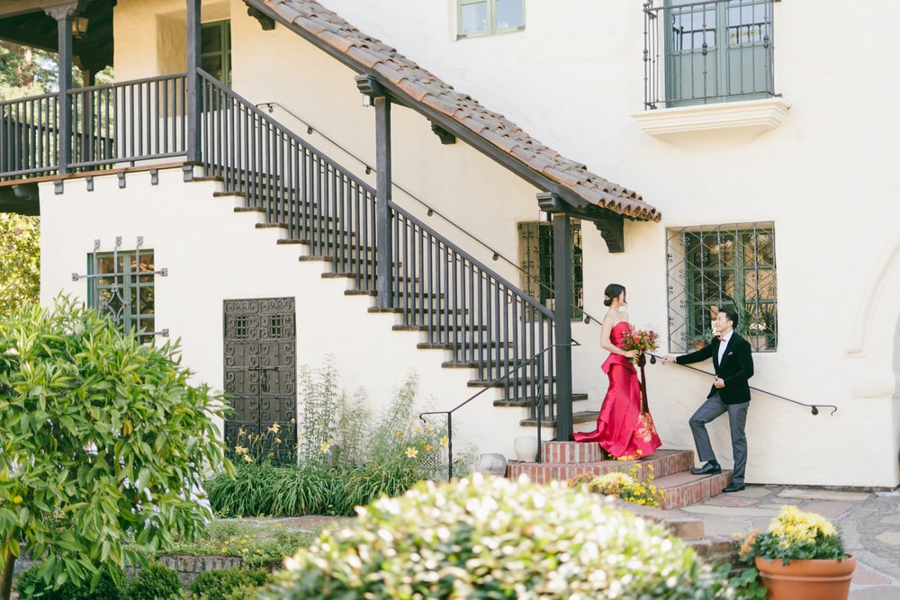 man and woman walking on the stairs