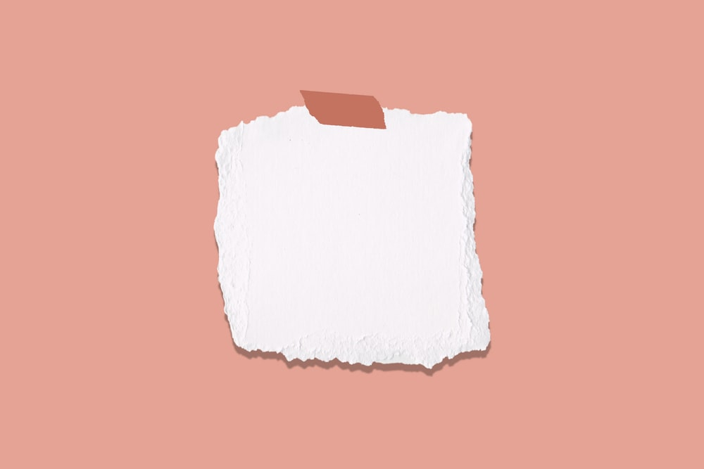 white and blue paper on pink surface