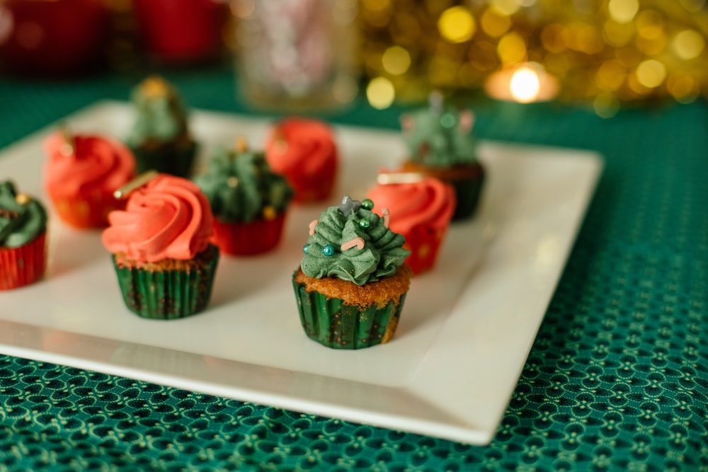 red and green cupcake on white table
