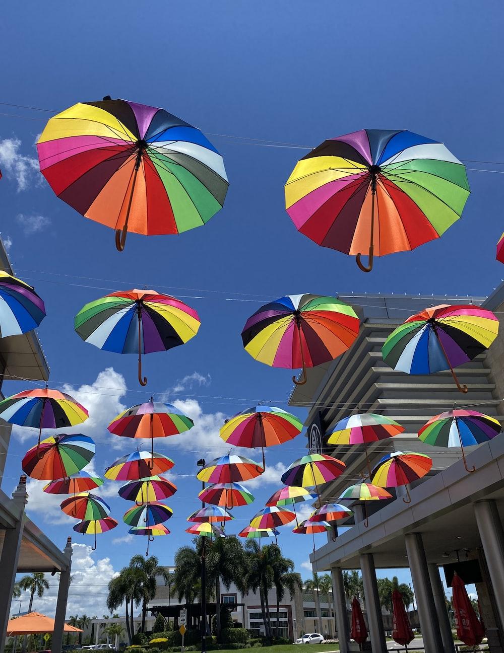 multi colored umbrella umbrella on the street