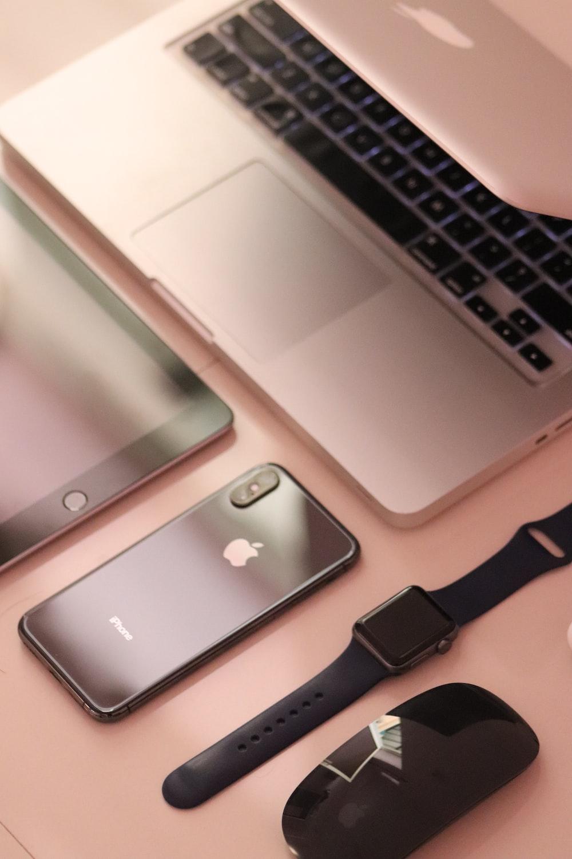 silver iphone 6 beside black watch