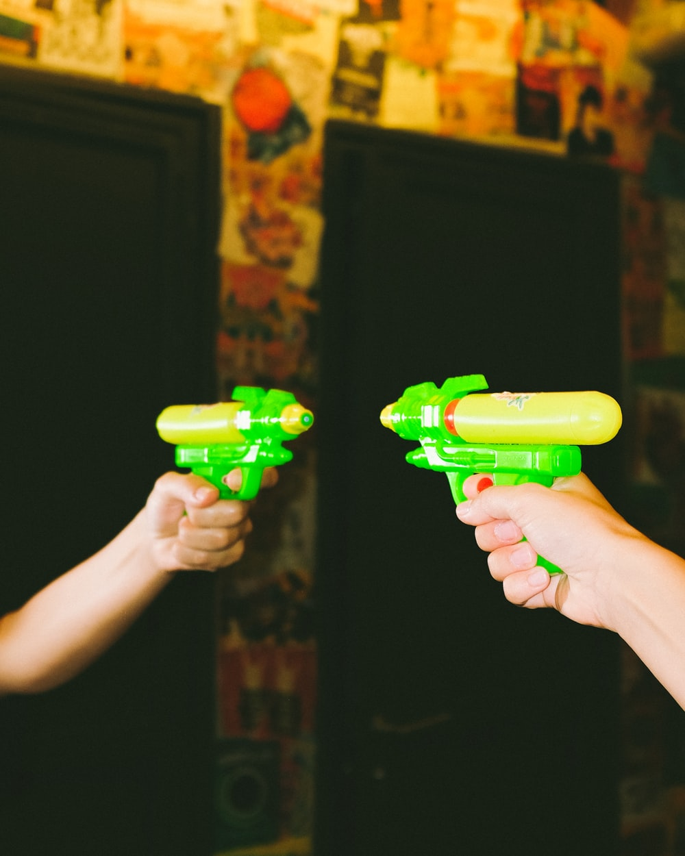 person holding green plastic toy