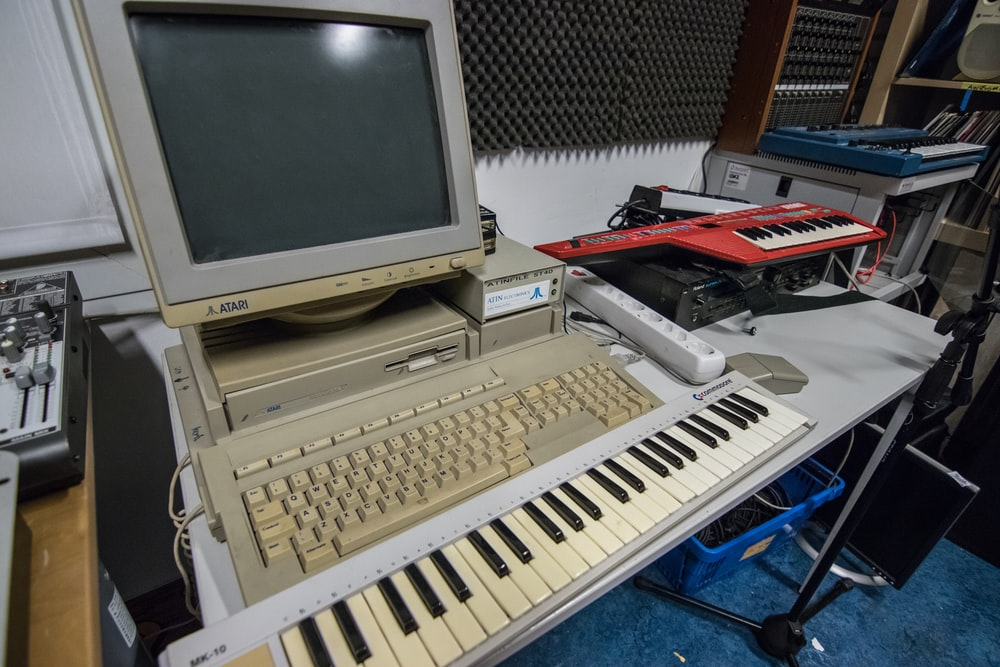 white computer monitor and white computer keyboard