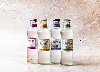 three clear glass bottles on white table