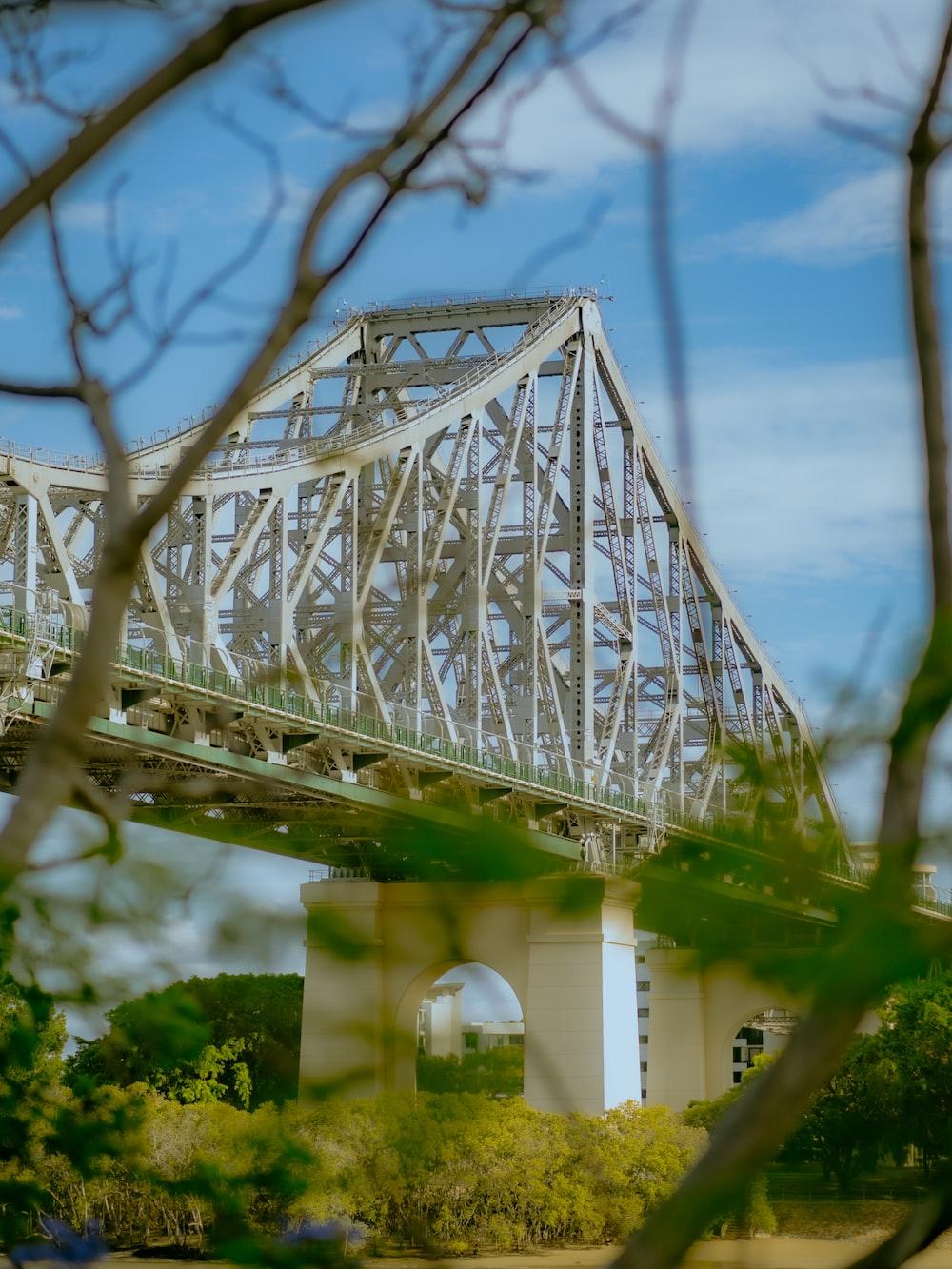 white metal bridge over the river