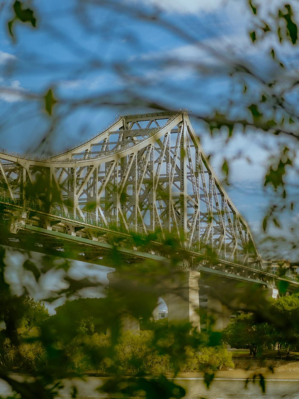white metal bridge over river