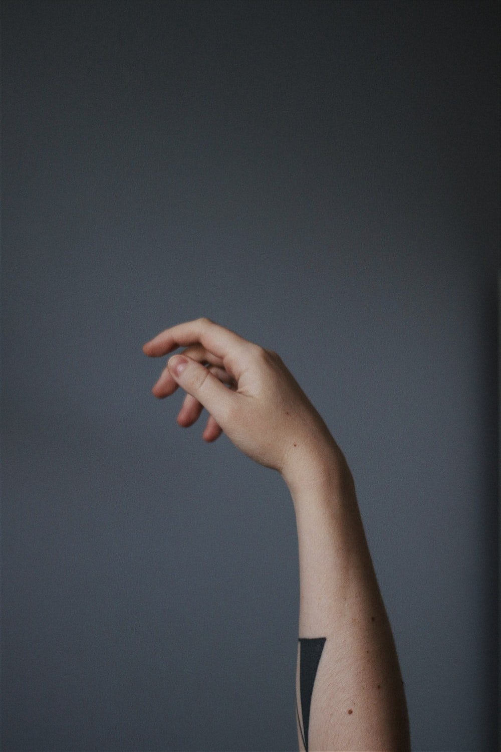persons left hand doing okay sign