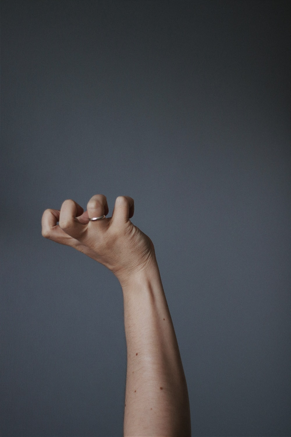 persons left hand doing thumbs up