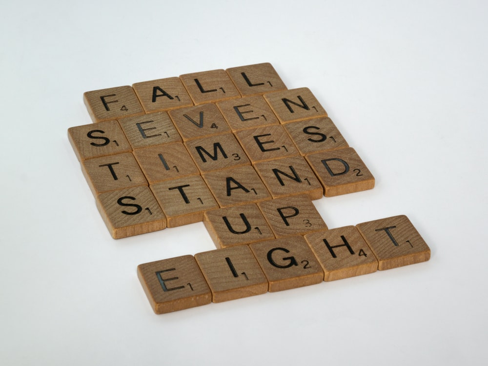 brown wooden puzzle game board