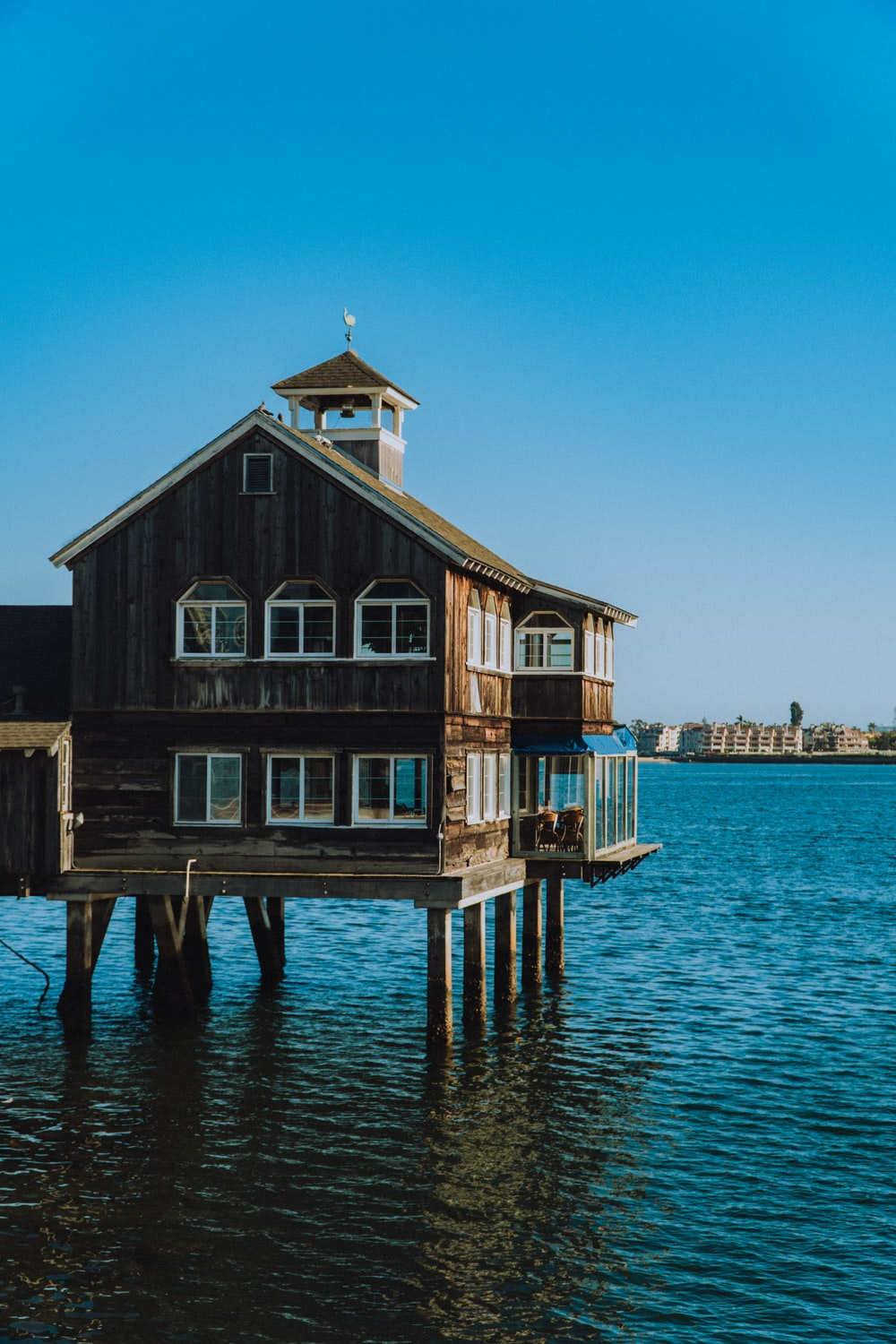 brown wooden house on dock during daytime