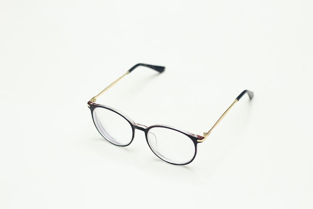brown framed eyeglasses on white surface
