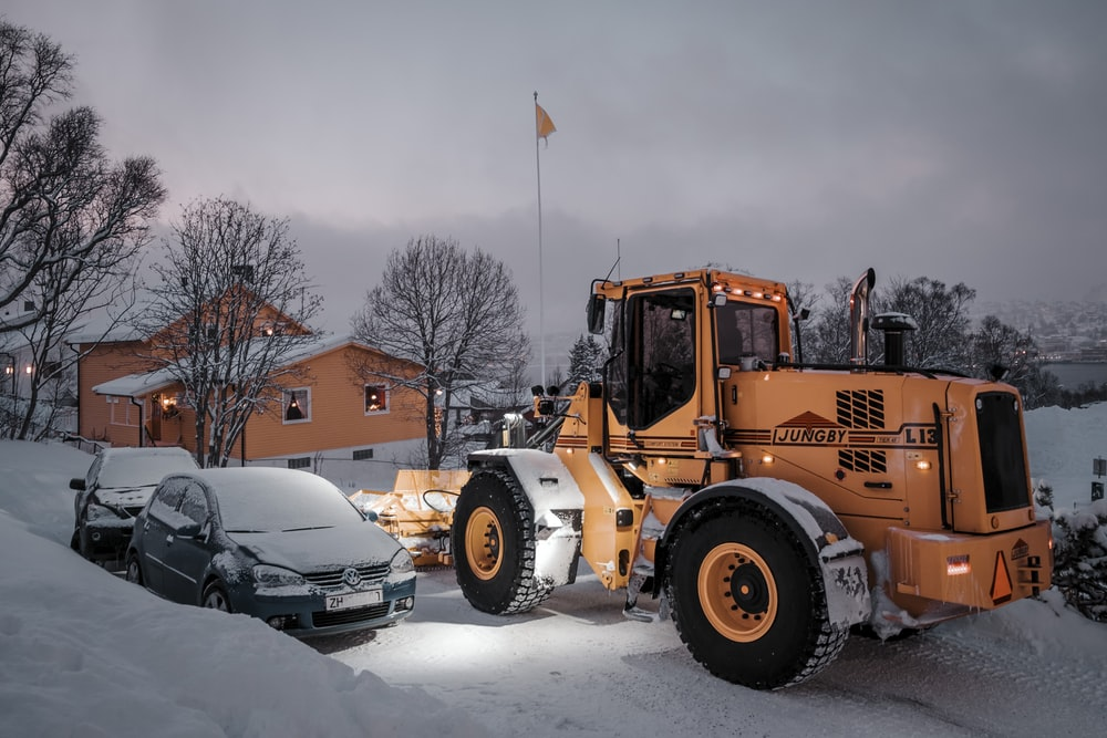 yellow and black heavy equipment on snow covered ground