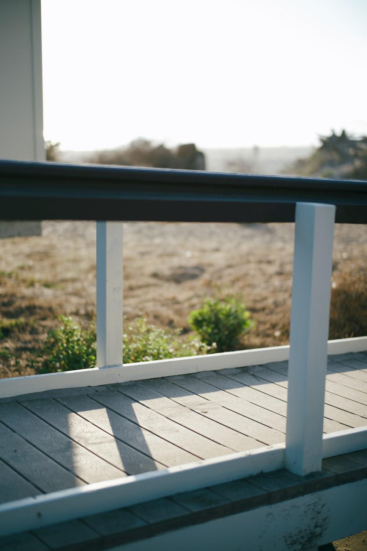 black metal railings near green grass field during daytime