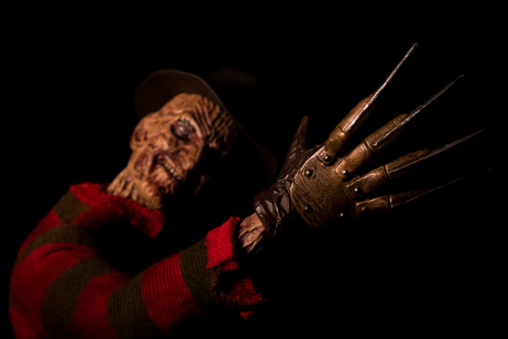 person in brown and red gloves
