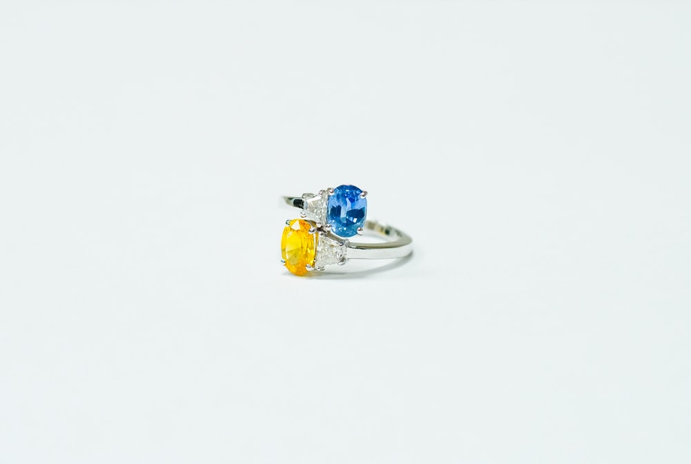 blue and silver ring on white surface