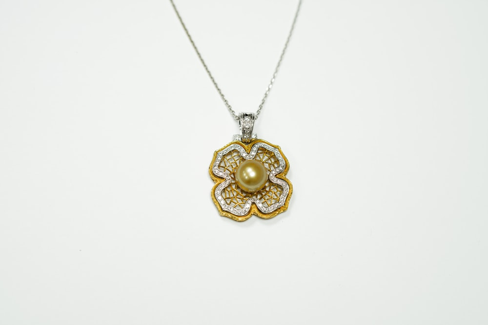 gold and silver heart pendant necklace