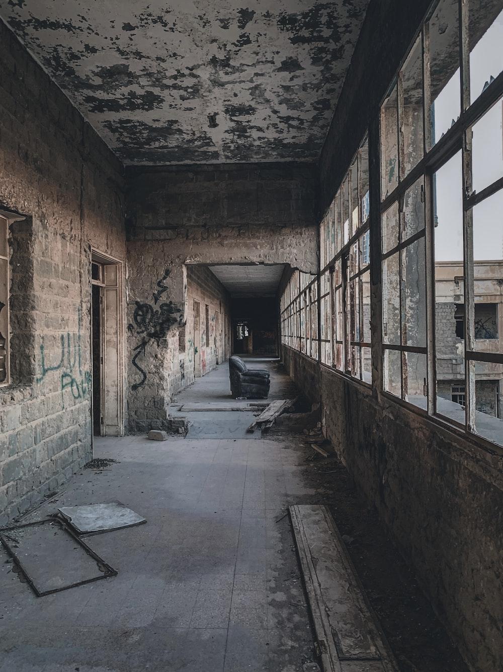 empty hallway with brown brick walls