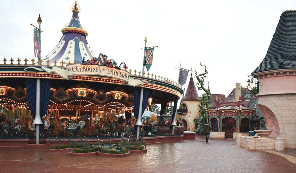 white and brown carousel under white sky during daytime