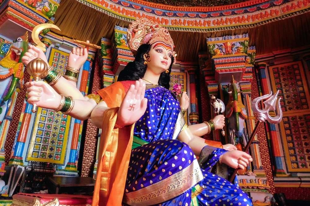 woman in purple and white sari dress