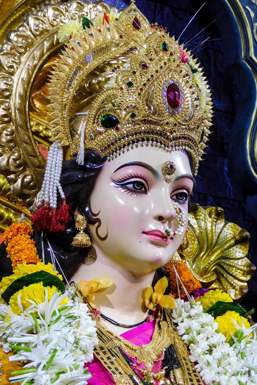 gold and white hindu deity figurine