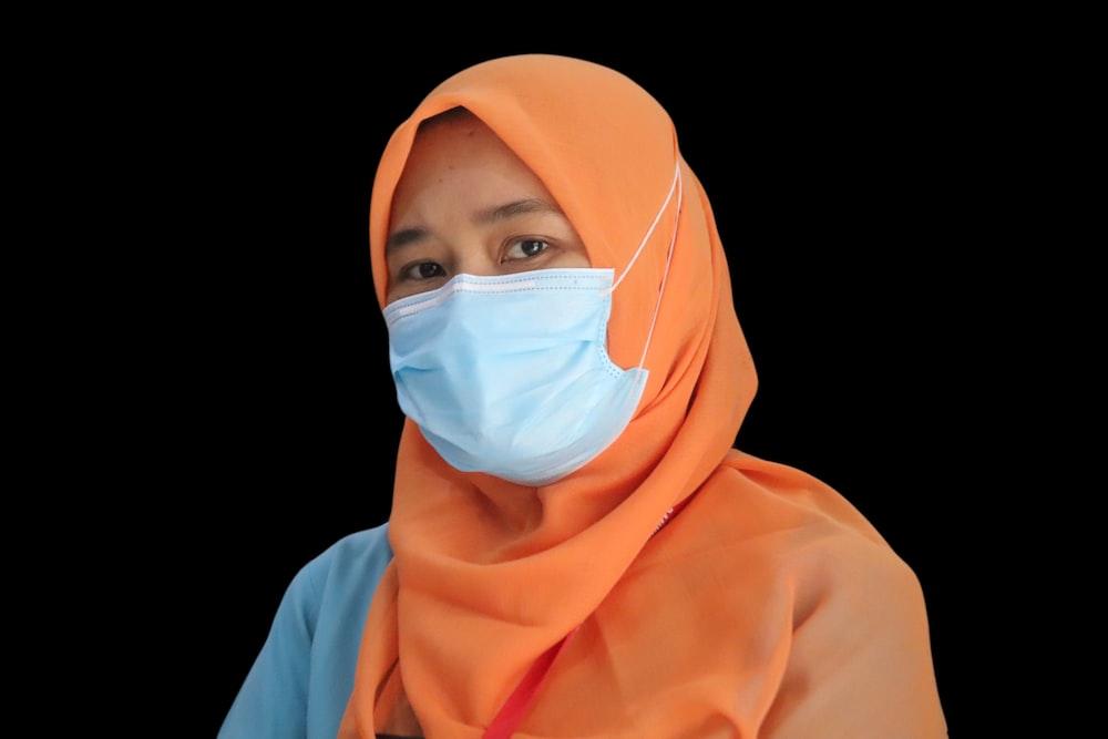woman in orange hijab and white hijab