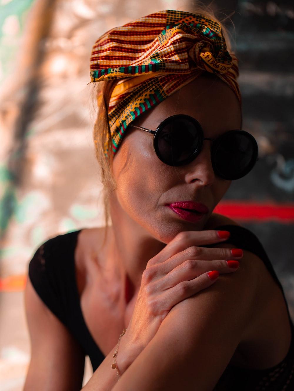 woman in black tank top wearing black sunglasses