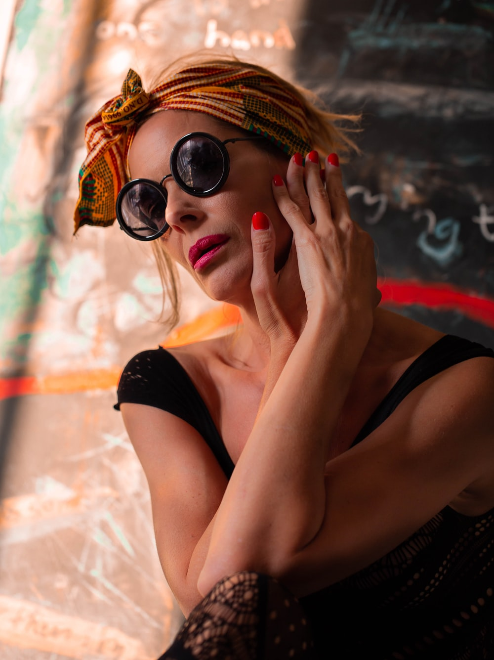 woman in black tank top wearing sunglasses