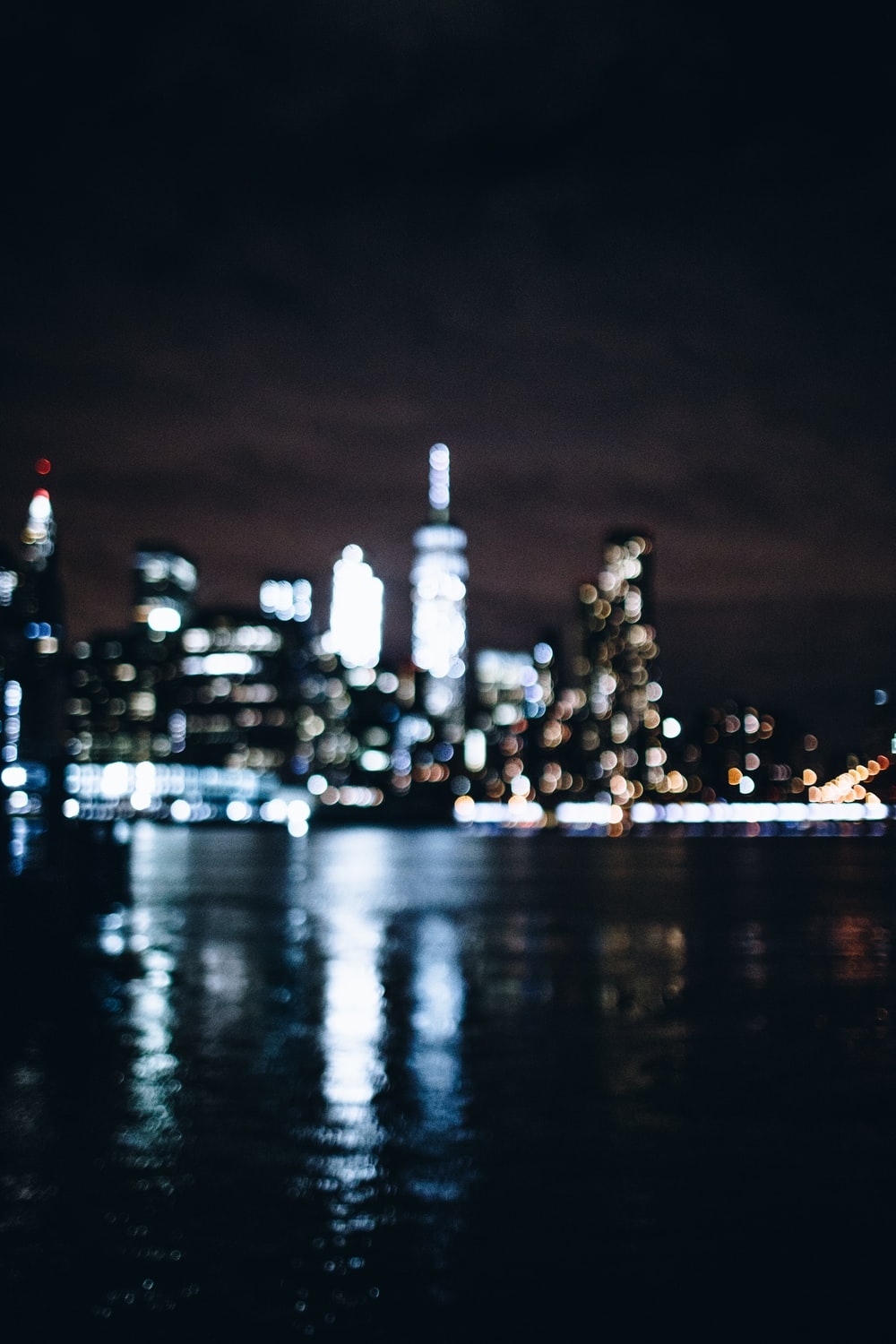city skyline during night time