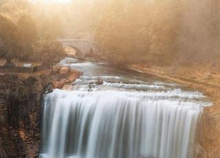 waterfalls in brown field during daytime