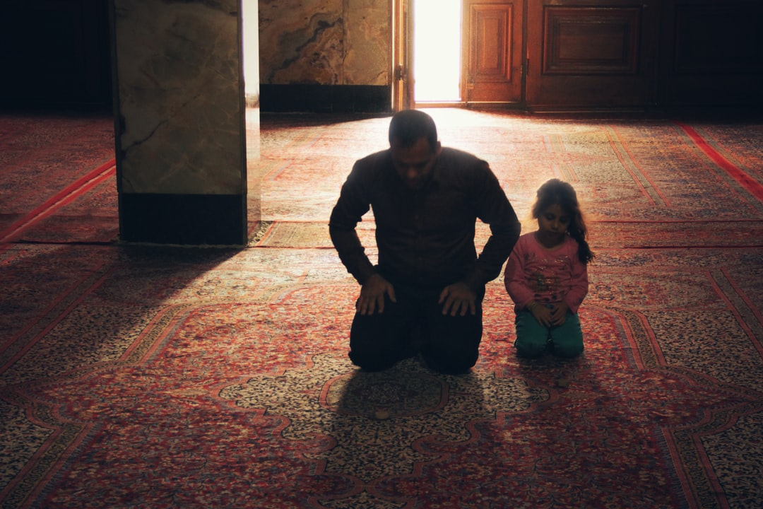 A Father and his Daughter Praying in a Mosque in Yazd, Iran